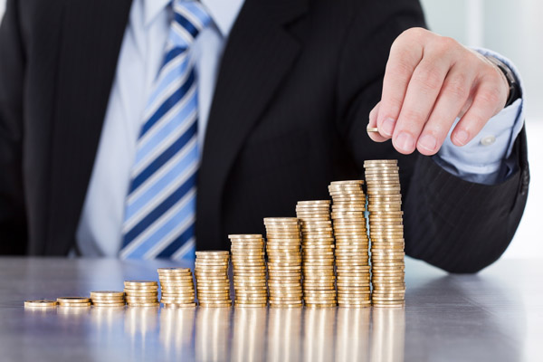 stockfresh_3838919_close-up-of-businessman-hand-put-coins-to-stack-of-coins_sizeM