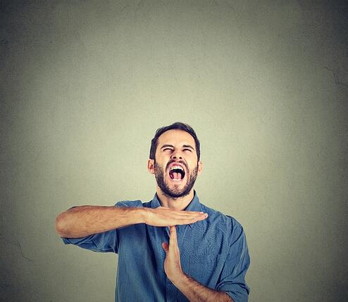 stockfresh_6353070_young-man-showing-time-out-hand-gesture-frustrated-screaming-to-stop_sizeS