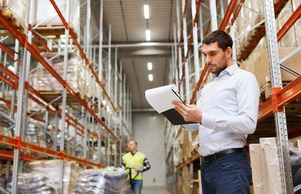 stockfresh_6992580_businessman-writing-to-clipboard-at-warehouse_resized