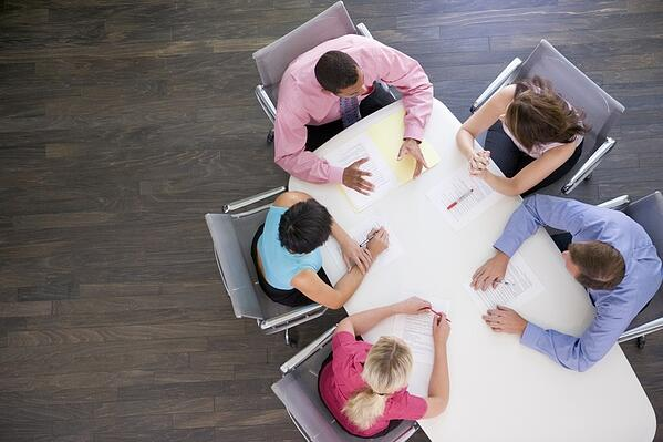 stockfresh_95289_five-businesspeople-at-boardroom-table_sizeS