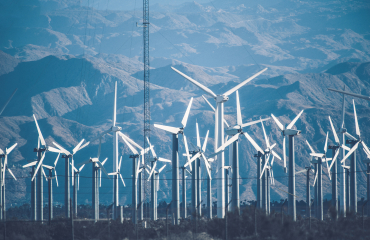 Energy - Wind Turbines in front of Mountains