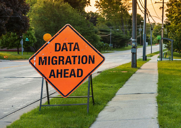 "Orange road sign that says ""Data Migration Ahead"""