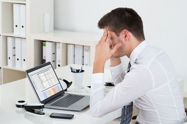 Frustrated businessman trying to unlock ERP potential