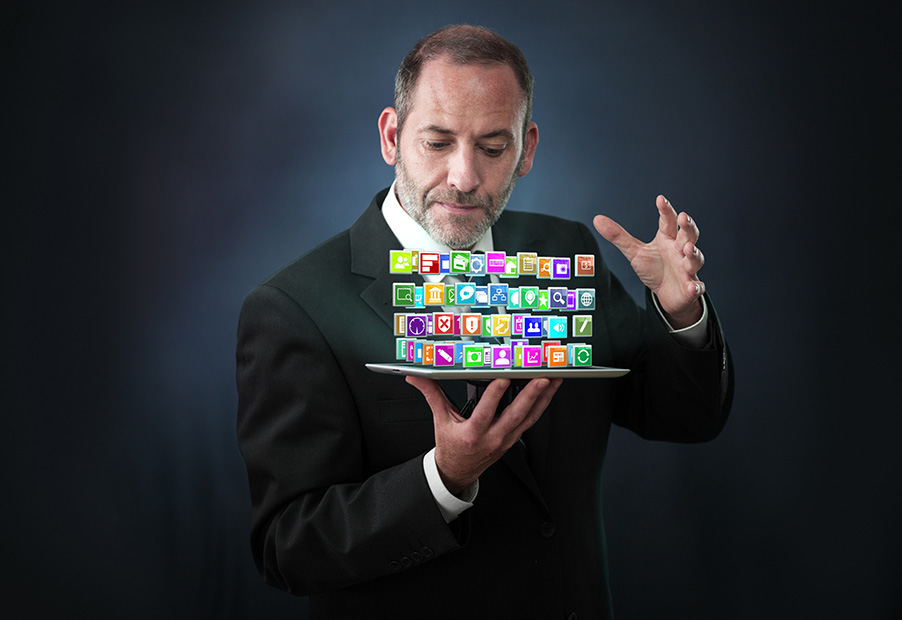 Magician Holding Tablet with ERP Consulting Apps